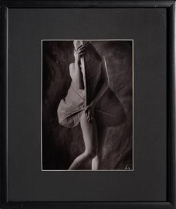 Sale 9116A - Lot 5049 - Louise Lister Girl With Banana Leaf silver gelatin photograph 39.5 x 27 cm (frame: 64 x 54 x 2 cm) signed lower right in monogram
