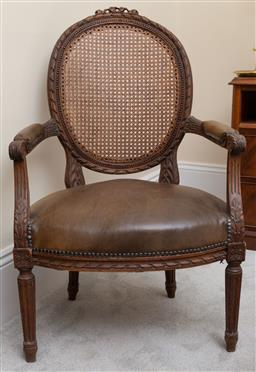 Sale 9190W - Lot 84 - An antique French cane back, leather upholsterd fauteuil.