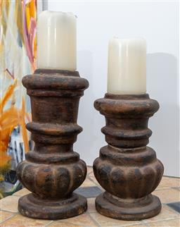 Sale 9191H - Lot 10 - A graduating pair of terracotta candle holders, H 37 and 31 cm