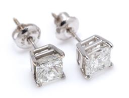 Sale 9213 - Lot 364 - A PAIR 18CT WHITE GOLD SOLITAIRE DIAMOND STUD EARRINGS; each claw set with a princess cut diamond on threaded post fittings, 2 diamo...