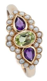 Sale 9054 - Lot 382 - A 9CT GOLD SUFFRAGETTE INSPIRED GEMSET RING; rub set across the top with an oval cut peridot and 2 pear cut amethyst all surrounded...