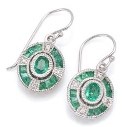 Sale 9177 - Lot 335 - A PAIR OF DECO STYLE EMERALD AND DIAMOND EARRINGS; each a 9ct white gold oval plaque centring an oval cut emerald to surround of mix...