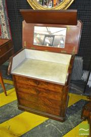 Sale 8255 - Lot 1078 - 19th Century French Flame Mahogany Washstand, the hinged top with mirror & mechanical marble lined shelf, with four drawers below (s...