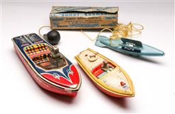 Sale 9131 - Lot 59 - Set of three vintage toy boats inc Snort submarine and robot boat