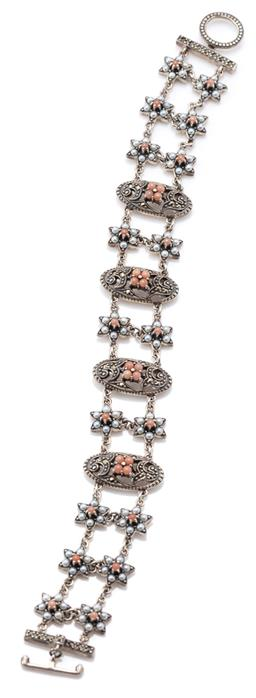 Sale 9164J - Lot 366 - A SILVER GEMSET BRACELET; 4 oval pierced plaques set with central coral bead cluster and swirls of marcasites to double row of seed...