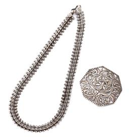 Sale 9186 - Lot 332 - A SILVER TRIBAL NECKLACE AND BROOCH; 10mm wide fancy link fringe necklace to hook clasp, length 37cm, pierced octagonal brooch featu...