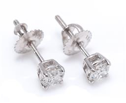 Sale 9221 - Lot 378 - A PAIR OF 18CT WHITE GOLD SOLITAIRE DIAMOND STUD EARRINGS; each claw set with a round brilliant cut diamond to threaded post fitting...