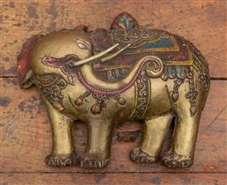 Sale 9160H - Lot 62 - A Tibetan brass and polychrome repousse elephant, glancing backwards with wall mountable hook, Width 26cm