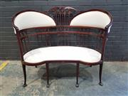 Sale 9014 - Lot 1017 - Edwardian Mahogany Kidney Shaped Settee, with finely pierced & padded back, in white calico, raised on slender legs (h:105 x w:125cm)