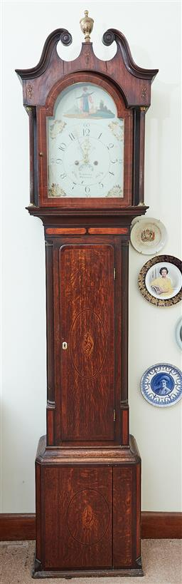 Sale 9103M - Lot 576 - A Georgian Mahogany and inlaid longcase clock by Bagnall of Belfast with column form supports and metal clock face, with pendulum an...