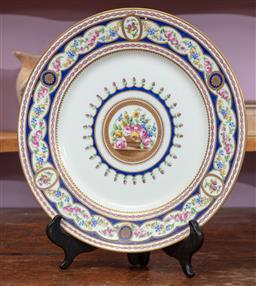 Sale 9120H - Lot 122 - A Sevres ceramic floral plate with gilded royal blue border, Diameter 25cm