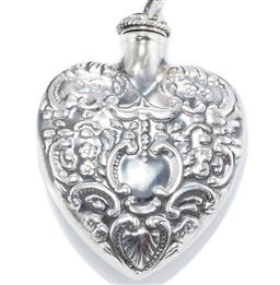 Sale 9164J - Lot 373 - A VICTORIAN STYLE SILVER PERFUME BOTTLE PENDANT ; heart shape repousse bottle, size 6 x 4cm, wt. 13.65g.
