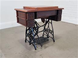 Sale 9255 - Lot 1038 - Early New Home sewing machine table (h80 x w87 x d48cm)