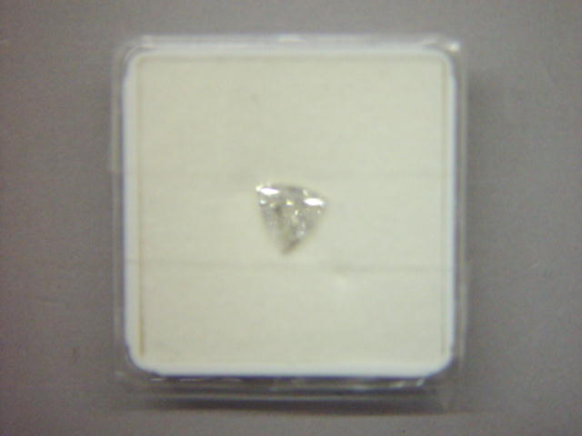 Sale 3545 - Lot 105A - UN UNSET TRILLIANT CUT DIAMOND;