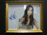 Sale 8125 - Lot 16 - Cher - signed photograph