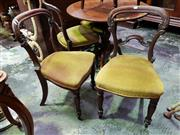 Sale 8666 - Lot 1079 - Set of Four Victorian Rosewood Chairs, with carved balloon backs, gold velvet seats & turned fluted legs (one back damaged)
