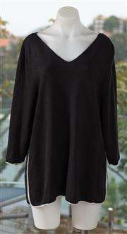 Sale 9044H - Lot 47 - A COS black Mohair/Wool mix jumper with white piping, size US L