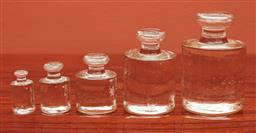 Sale 9108H - Lot 79 - A set of five graduated glass postal weights, Tallest 8.5cm