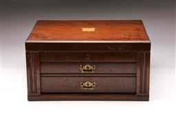 Sale 9110 - Lot 307 - Large lift top timber cutlery case with two drawers by Petersens Ltd. (H24cm x W46.5cm x D35cm) with cartouche to top