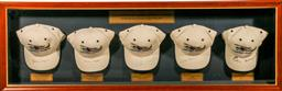 Sale 9144 - Lot 107 - A Collection of Snowy Hydro Signed Caps By Governor Generals in display case (124cm cm x 40cm)