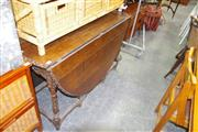 Sale 8115 - Lot 1475 - 19th Century Oak Gate-leg Table, forming an oval top & carved turned supports