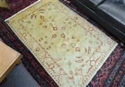 Sale 8205 - Lot 31 - A signed Persian silk carpet on gold ground with red geometric and floral motif, approx 160 x 300cm
