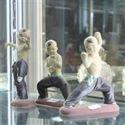 Sale 8300 - Lot 31 - Chinese Pottery Set of Three Tai-Chi Boy Figures