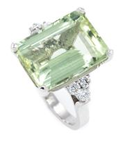 Sale 8905J - Lot 384 - A GREEN BERYL AND DIAMOND COCKTAIL RING; corner claw set in 18ct white gold with a step cut green beryl of approx. 12ct, between ups...