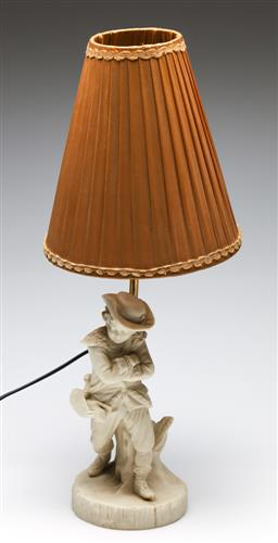 Sale 9253 - Lot 47 - A brass table lamp on bisque figural base (H:50.5cm - with shade)