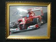 Sale 8125 - Lot 15 - Fernando Alonso - signed action photograph