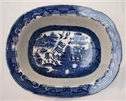 Sale 8319 - Lot 202 - A large pie dish in blue and white willow pattern, c 1890