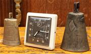 Sale 8942H - Lot 37 - A vintage Westclox alarm clock together with two cow bells