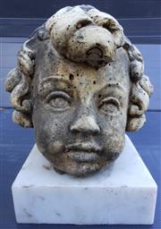 Sale 8312A - Lot 19 - A cast stone head of a cherub on white marble base, overall height 23 cm