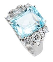 Sale 8905J - Lot 388 - A PLATINUM AQUAMARINE AND DIAMOND RING; centring a radiant cut aquamarine of approx. 4.25ct to split shoulders each set with 3 round...