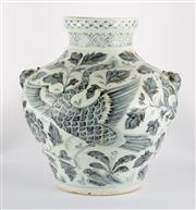 Sale 8536 - Lot 84 - A Ming style blue and white jar with beast handles, decorated with flowers and phoenix, H 33cm