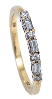 Sale 8991 - Lot 310 - AN 18CT GOLD QUARTER HOOP DIAMOND RING; 2.29mm wide band set across the top with 4 round brilliant and 3 baguette cut diamonds (1 ch...