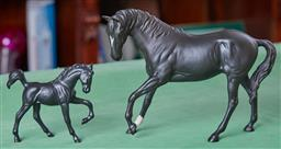 Sale 9103H - Lot 77 - A Doulton Stallion together with a Beswick mare in a black finish, Height of taller 18cm