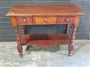 Sale 8993 - Lot 1085 - Late 19th Century Cedar Hall Table or Washstand, with three drawers, turned legs & shaped shelf (H:76 W:96 D:44cm)