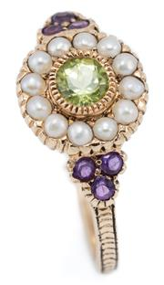Sale 9054 - Lot 384 - A DAINTY GEMSET SUFFRAGETTE STYLE RING; featuring a cluster of round cut peridot to seed pear surround and shoulders set with round...