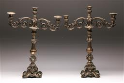 Sale 9122 - Lot 153 - A Pair of Silver Three (.800) Branch Candelabra H: 48cm (loaded bases)