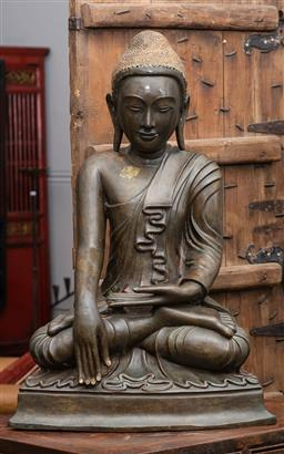 Sale 9160H - Lot 66 - A late c.19th/ early c.20th Burmese bronze seated buddha figure with green stone inlay to ceramic crown, some cracks, total Height 8...