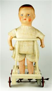 Sale 8330T - Lot 81 - German Walker Doll and Bisque Dolls; 1930s composition doll in timber clockwork walking frame and 6 Japanese and German bisque kewp...