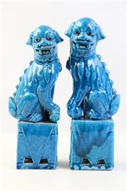 Sale 8997A - Lot 649 - Pair of blue glazed Fo dogs (H31.5cm)