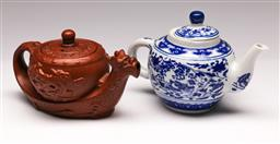 Sale 9136 - Lot 264 - A Yixing teapot (L 17cm) together with A blue and white ceramic teapot (H 13cm)