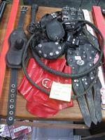 Sale 7926A - Lot 1726 - Leather implements including posture collar and hood