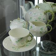 Sale 8236 - Lot 89 - Belleek 3-Piece Tea Setting with a Matching Cup Saucer