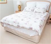 Sale 8562A - Lot 216 - A Sealy Posturpedic Private Label Collection manufactured for David Jones double bed, with cream fabric headboard, and matching beds...
