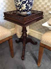 Sale 8815A - Lot 35 - A pair of hand carved mahogany lamp tables. The reticulated galleries onto a rope edged freize on a tapering ring turned and acanthu...
