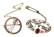 Sale 8928 - Lot 311 - TWO ANTIQUE GOLD STONE SET BROOCHES; 34mm wide oval set with a garnet topped doublet and seed pearls, other 21mm circle set with see...
