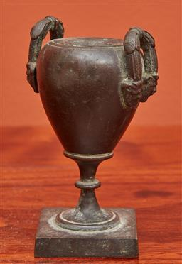 Sale 9108H - Lot 87 - A small antique bronze urn on footed base. Height 10cm